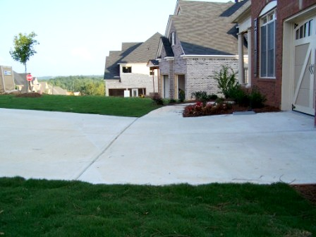 Solving drainage problems for Sloped driveway options