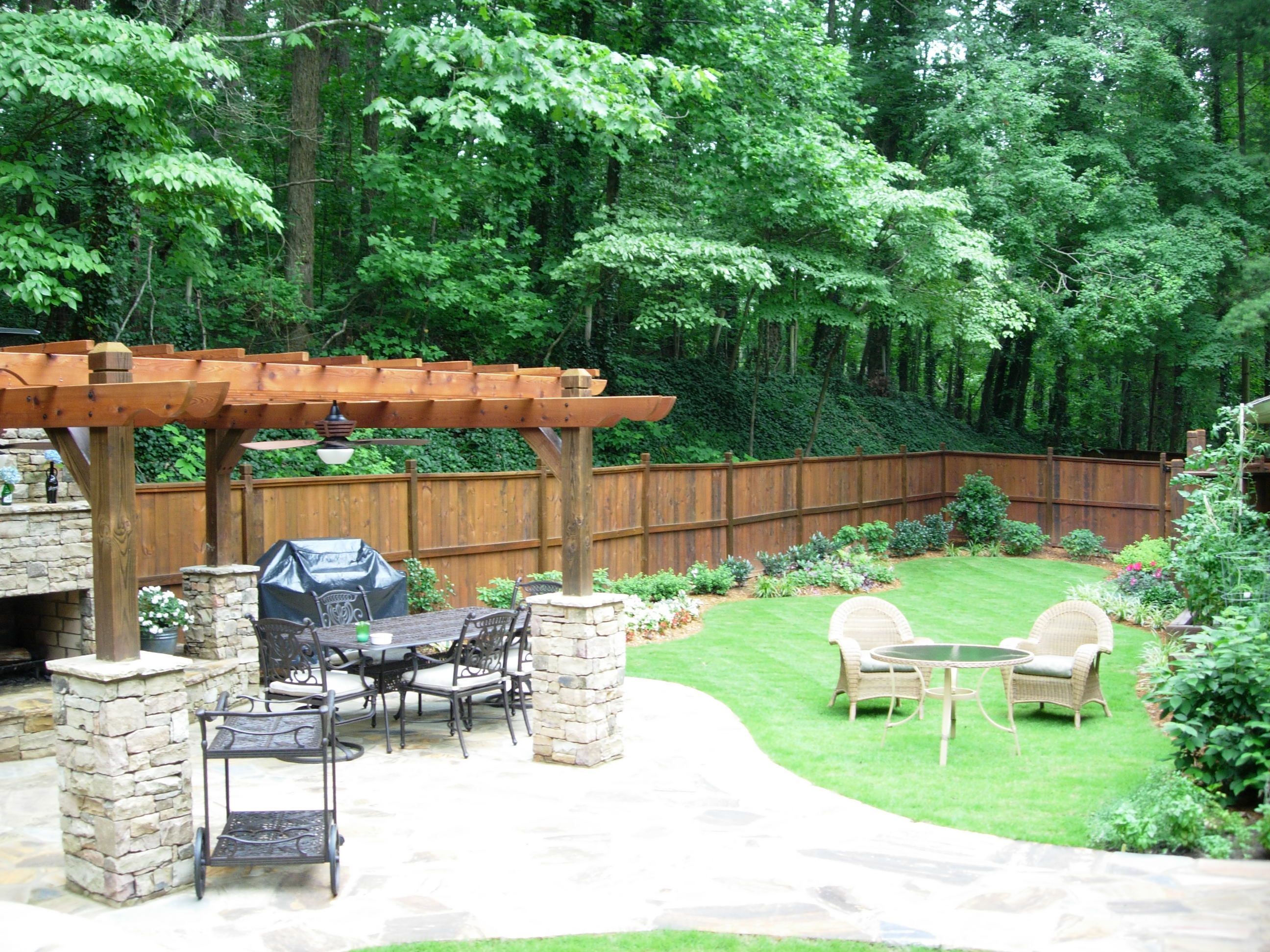This Backyard Design Includes A New Cedar Fence Around The Entire Yard. A  Large Crab Orchard Stone Patio With A Pergola Over The Patio Near The  Outdoor ...